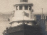Tug Boat at Harbor Pier