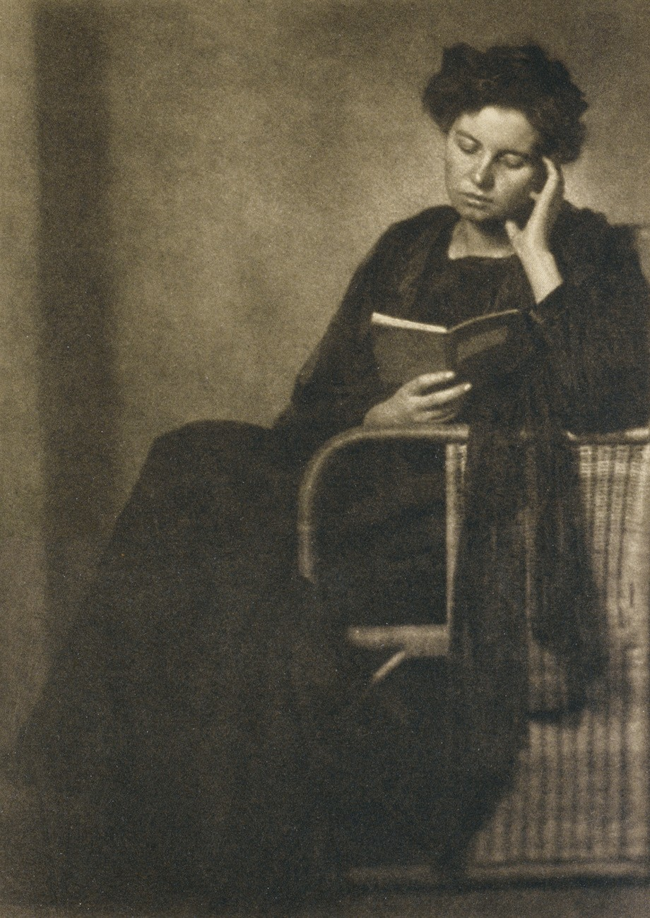 unidentified woman reading a book photoseed