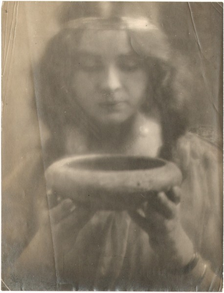 Portrait of Woman Holding up Bowl