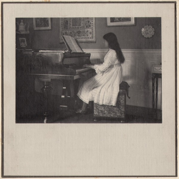 Young Girl At Piano
